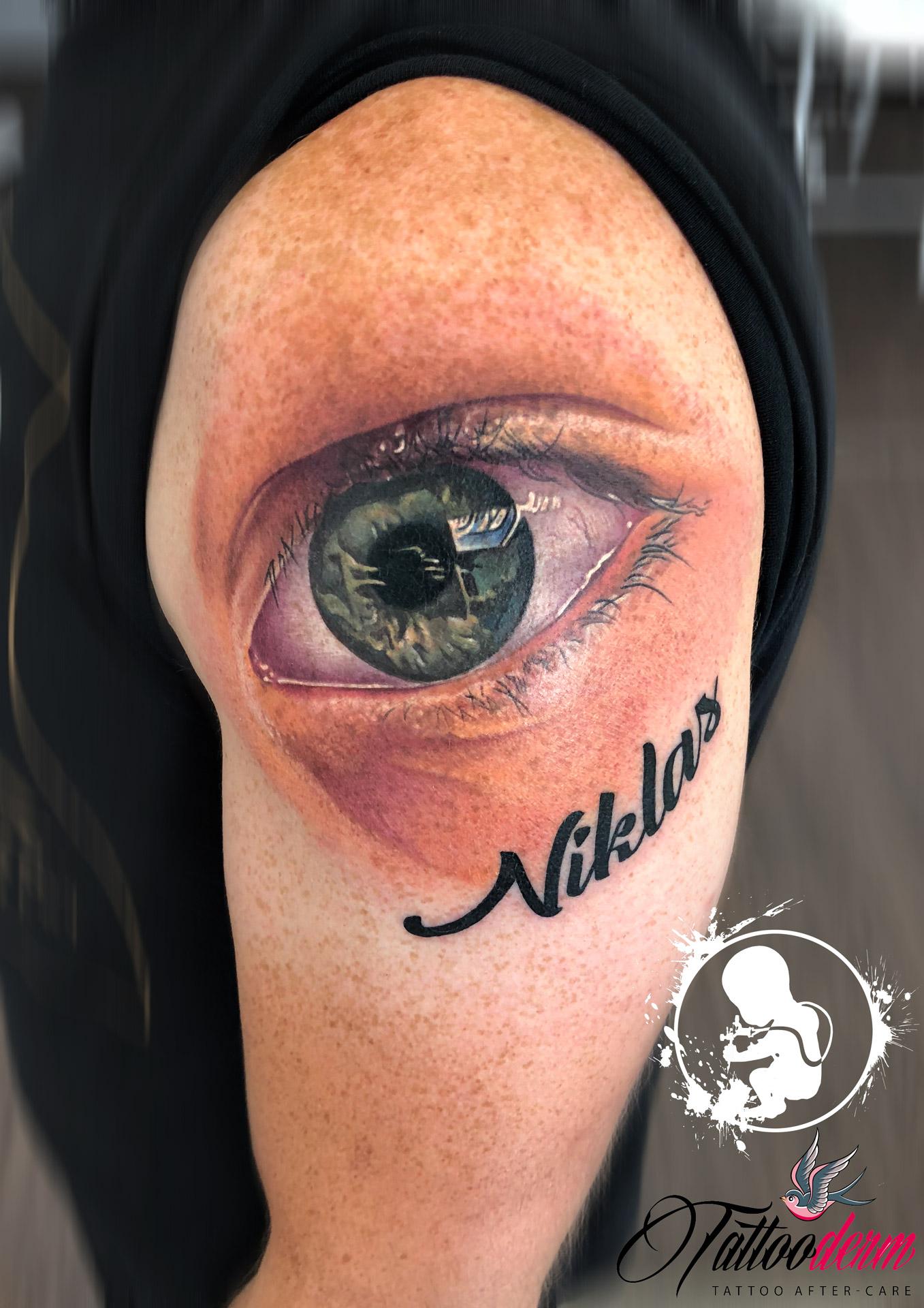 Auge Oberarm | Thomas | Newborn Tattoo Wolfratshausen